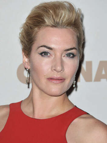 Kate Winslet Kate positively glows (could it be a spray tan) at the Carnage premiere in a red frock topped off with a sophisticated pompadour updo.  Reprinted with Permission of Hearst Communications, Inc. Originally Published: 60 Best Celebrity Makeovers of All Time Photo: Getty Images
