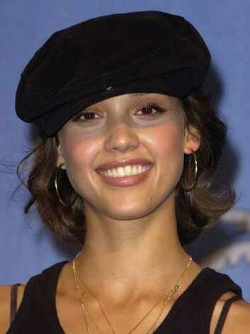 Jessica Alba Exposed bra straps and a cap are the highlight of Alba's street casual red carpet look at the 2002 Teen Choice Awards.  Reprinted with Permission of Hearst Communications, Inc. Originally Published: 60 Best Celebrity Makeovers of All Time Photo: Getty Images