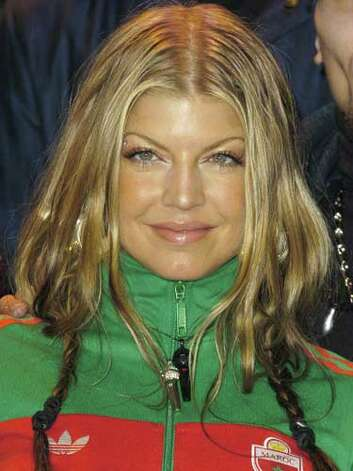 Fergie As the only female member of the hip hop group Black Eyed Peas, Fergie wore pigtails and an adidas track suit while hanging with the boys at the 2004 Grammy Awards Nominations.  Reprinted with Permission of Hearst Communications, Inc. Originally Published: 60 Best Celebrity Makeovers of All Time Photo: Getty Images