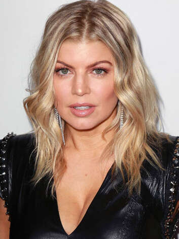 Fergie Fergie still has that punk style with this leather and spike encrusted top worn at former bandmate apl.de.ap's birthday celebration, but shorter cut and glowing makeup highlight her more feminine side.  Reprinted with Permission of Hearst Communications, Inc. Originally Published: 60 Best Celebrity Makeovers of All Time Photo: Getty Images