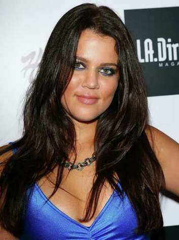 Khloe Kardashian Matching electric blue eyeshadow to her spandex top was a freshman beauty move for Khloe Kardashian at the L.A. Direct Magazine Expansion Party in 2007.  Reprinted with Permission of Hearst Communications, Inc. Originally Published: 60 Best Celebrity Makeovers of All Time Photo: Getty Images / 2007 Michael Tran