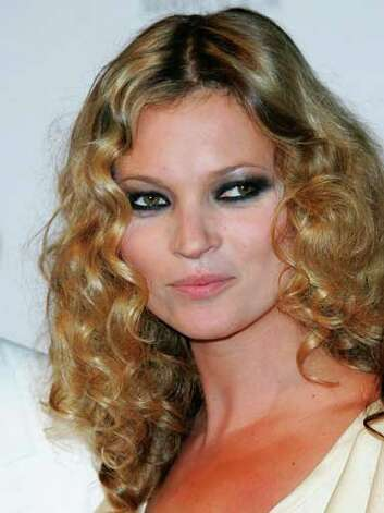 Kate Moss Kate's soft curls at the 2004 Alexander McQueen fashion show contrast with her raccoon eye makeup in a way that is only acceptable for couture models.  Reprinted with Permission of Hearst Communications, Inc. Originally Published: 60 Best Celebrity Makeovers of All Time Photo: Getty Images