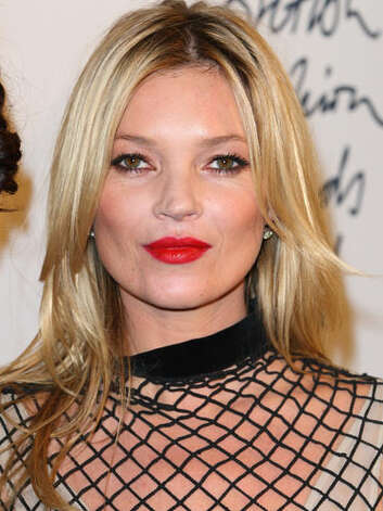Kate Moss A fishnet dress, candy apple red lips and a straight blonde style at the 2011 British Fashion Awards are just an example of how Kate has kept on the edge of fashion as a modeling icon.  Reprinted with Permission of Hearst Communications, Inc. Originally Published: 60 Best Celebrity Makeovers of All Time Photo: Getty Images