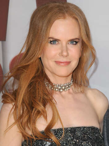 Nicole Kidman At the 2011 CMA Awards Nicole's style is much more relaxed. Her strawberry blonde waves and diamond choker fit right in with her new laid-back lifestyle.  Reprinted with Permission of Hearst Communications, Inc. Originally Published: 60 Best Celebrity Makeovers of All Time Photo: Getty Images