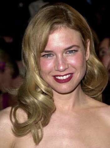 Renée Zellweger Renée's old Hollywood curls and red lipstick does little to bring warmth to her fair skin tone at the 2001 Vanity Fair Oscar Party.  Reprinted with Permission of Hearst Communications, Inc. Originally Published: 60 Best Celebrity Makeovers of All Time Photo: Getty Images