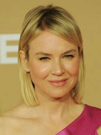 Renée Zellweger At the 2010 CNN Heroes Awards, Renée's shoulder-length bob better complements her heart-shaped face and her hot pink gown is a touch of color on her glowing skin.  Reprinted with Permission of Hearst Communications, Inc. Originally Published: 60 Best Celebrity Makeovers of All Time Photo: Getty Images / 2010 AFP