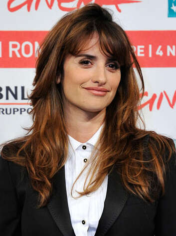 Penelope Cruz Penelope continues to have a love for menswear in this blazer and button up combo. However her long hair balances out her masculine attire at the 2011 Rome Film Festival.  Reprinted with Permission of Hearst Communications, Inc. Originally Published: 60 Best Celebrity Makeovers of All Time Photo: Getty Images