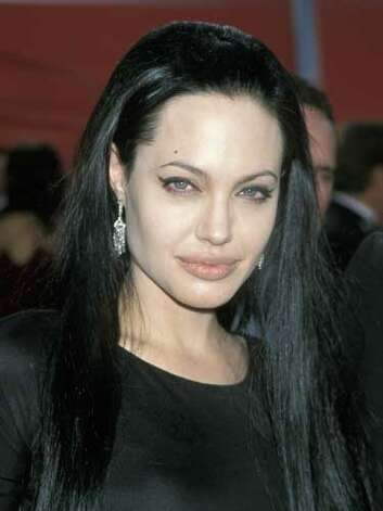 Angelina Jolie At the 2000 Academy Awards Angelina opts for a goth red carpet look. Her long black tresses, black dress and winged eyeliner remind of us Morticia of the Addams Family.  Reprinted with Permission of Hearst Communications, Inc. Originally Published: 60 Best Celebrity Makeovers of All Time Photo: Getty Images