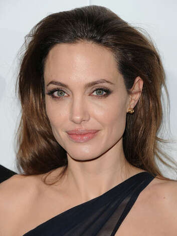 Angelina Jolie Angelina has lightened up her look significantly at the 2011 In the Land of Blood and Honey premiere. She is glowing in a single strap dress, long highlighted strands, and of course her full pink lips.  Reprinted with Permission of Hearst Communications, Inc. Originally Published: 60 Best Celebrity Makeovers of All Time Photo: Getty Images