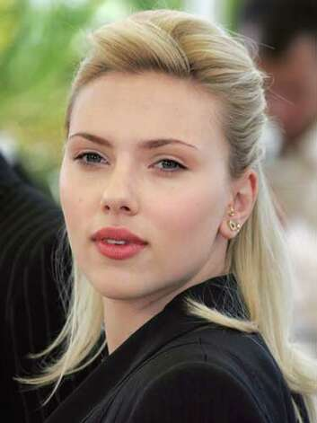 Scarlett Johansson Scarlett Johansson's fair-haired look does light our fancy. She exudes the sex appeal of a blonde bombshell at the 2005 Cannes Film Festival.  Reprinted with Permission of Hearst Communications, Inc. Originally Published: 60 Best Celebrity Makeovers of All Time Photo: Getty Images / 2005 AFP