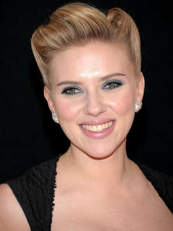 Scarlett Johansson After a brief stint as a redhead, ScarJo is back to a honey blonde hue at the premiere of We Bought a Zoo. Her retro updo and sweetheart neckline convey the confidence of a serious actress instead of a sex kitten.     Reprinted with Permission of Hearst Communications, Inc. Originally Published: 60 Best Celebrity Makeovers of All Time Photo: Getty Images