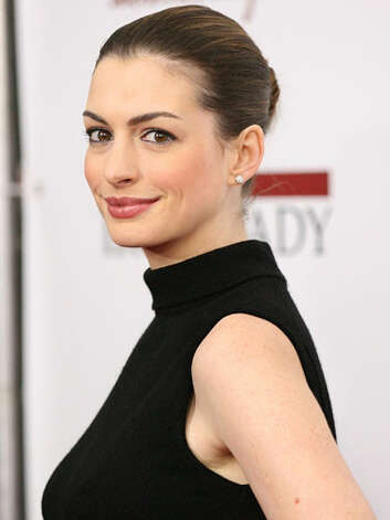 Anne Hathaway At the 2011 The Iron Lady premiere, Anne has found a more poised style with her slicked back bun, turtleneck dress, and rose pink lip color.  Reprinted with Permission of Hearst Communications, Inc. Originally Published: 60 Best Celebrity Makeovers of All Time Photo: Getty Images