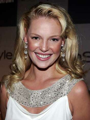 Katherine Heigl Katherine is overwhelmed by her long curls at a 2006 Grey's Anatomy cast party. Her choice of a rhinestone encrusted shirt is less than flattering to her curvy body type.  Reprinted with Permission of Hearst Communications, Inc. Originally Published: 60 Best Celebrity Makeovers of All Time Photo: Getty Images / 2006 Getty Images