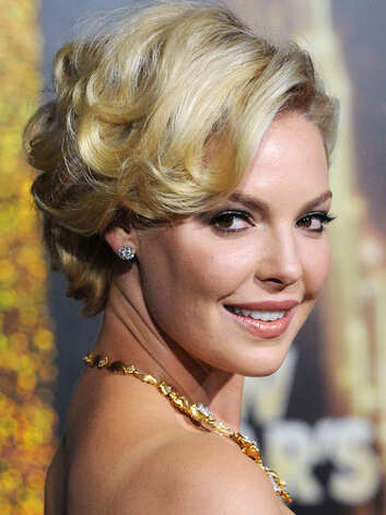 Katherine Heigl At the  New Year's Eve premiere, Katherine has chopped of her weighty locks and created a hair look that is sultry and voluminous.  Reprinted with Permission of Hearst Communications, Inc. Originally Published: 60 Best Celebrity Makeovers of All Time Photo: Getty Images
