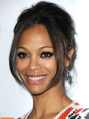"Zoë Saldana Zoë's straightened updo, smoky eyes and outfit with intricate designs at ""Trevor LIVE"" is proof that she has left the sun and sand behind for high fashion,  Reprinted with Permission of Hearst Communications, Inc. Originally Published: 60 Best Celebrity Makeovers of All Time Photo: Getty Images"