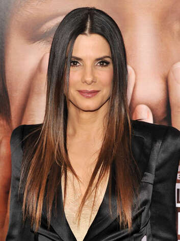 Sandra Bullock At the premiere of Extremely Loud & Incredibly Close, Sandra's ombre hairstyle, blazer with sever shoulder pads, and deep lipcolor exhibit her transition from sweet to serious.  Reprinted with Permission of Hearst Communications, Inc. Originally Published: 60 Best Celebrity Makeovers of All Time Photo: Getty Images