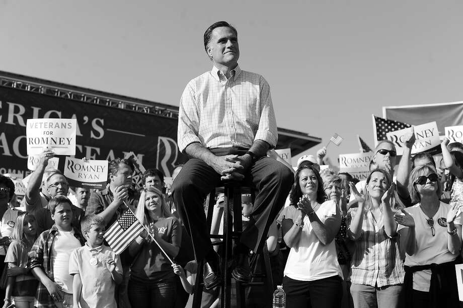 BLACK AND WHITE VERSION - US Republican presidential candidate Mitt Romney listens as his running mate Paul Ryan speaks during a campaign rally at the village green park in Powell, Ohio, on August 25, 2012. After months of campaigning, US Republicans meet in Tampa, Florida, August 27-30 to officially crown Mitt Romney the nominee to challenge US President Barack Obama for the White House in November. AFP PHOTO/Jewel Samad        (Photo credit should read JEWEL SAMAD/AFP/GettyImages) Photo: JEWEL SAMAD, AFP/Getty Images / 2012 AFP
