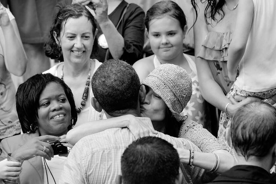 BLACK AND WHITE VERSION - A supporter kisses US President Barack Obama after he spoke at a rain-soaked campaign event on July 14, 2012 at Walkerton Tavern & Gardens in Glen Allen, Virginia. Obama is campaigning in Virginia for the second straight day ahead of the November presidential election.    AFP PHOTO/Mandel NGAN        (Photo credit should read MANDEL NGAN/AFP/GettyImages) Photo: MANDEL NGAN, AFP/Getty Images / 2012 AFP