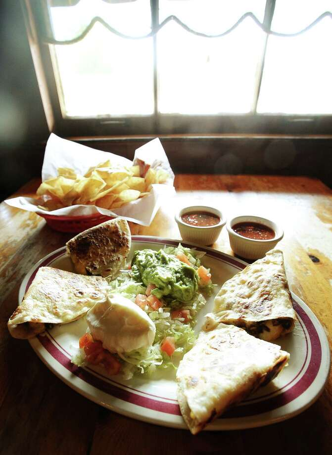 Taco Rey, an eclectic and super-fun Mexican/Tex-Mex restaurant in Nederland offers amazing beef quesadillas, just the smell will have your mouth watering. Photo taken: Randy Edwards/The Enterprise Photo: Randy Edwards