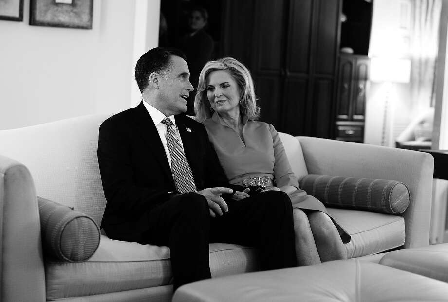 BLACK AND WHITE VERSION - US Republican presidential candidate Mitt Romney talks with his wife Ann as they watch the Republican National Convention (RNC) on TV in their hotel room before heading to the RNC at the Tampa Bay Times Forum in Tampa, Florida, on August 28, 2012. Romney's image will get a carefully scripted makeover during the convention as the Republican White House hopeful aims to close the yawning likability gap between himself and President Barack Obama. AFP PHOTO/Jewel Samad        (Photo credit should read JEWEL SAMAD/AFP/GettyImages) Photo: JEWEL SAMAD, AFP/Getty Images / 2012 AFP