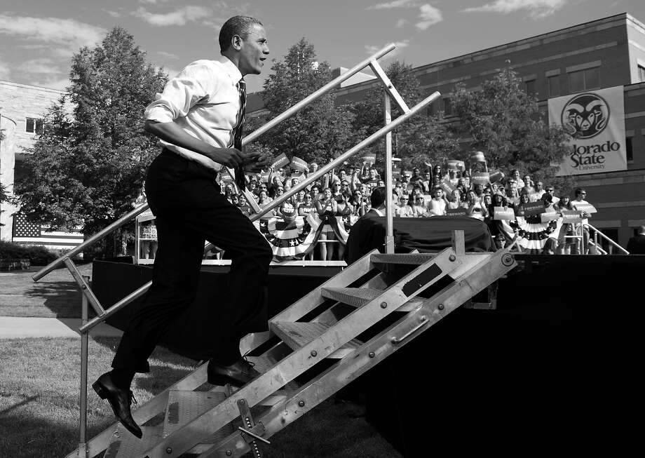 BLACK AND WHITE VERSION - US President Barack Obama arrives to speak during a campaign event at Colorado State University in Fort Collins, Colorado, August 28, 2012.   AFP PHOTO / Saul LOEB        (Photo credit should read SAUL LOEB/AFP/GettyImages) Photo: SAUL LOEB, AFP/Getty Images / 2012 AFP