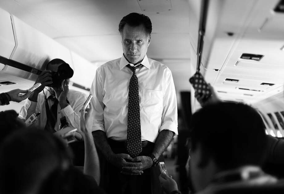 BLACK AND WHITE VERSION - US Republican presidential candidate Mitt Romney listens to a question as he talks to journalists about his phone call with Israeli Prime Minister Benjamin Netanyah on board his campaign plane on September 28, 2012. With 39 days to go for the election and polls showing an narrowing path to victory for the Republican nominee, Romney warned a second Obama term would be subsumed by economic malaise as he tried to draw the battle away from his own perceived missteps and back to the president's economic record. AFP PHOTO/Jewel Samad        (Photo credit should read JEWEL SAMAD/AFP/GettyImages) Photo: JEWEL SAMAD, AFP/Getty Images / 2012 AFP