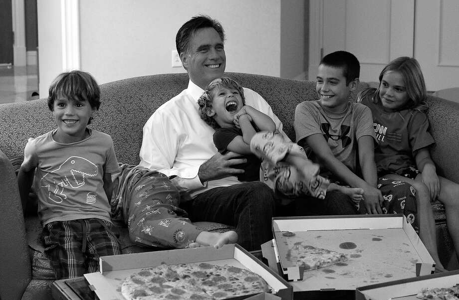 BLACK AND WHITE VERSION - US Republican presidential candidate Mitt Romney along with his grandchildren watches the Republican National Convention on television in their hotel room in Tampa, Florida, on August 29, 2012. Romney lies neck-and-neck with Obama in national polls 10 weeks before an election that should be his for the taking, given the sour economy and an unemployment rate that is lingering stubbornly above eight percent. AFP PHOTO/Jewel Samad        (Photo credit should read JEWEL SAMAD/AFP/GettyImages) Photo: JEWEL SAMAD, AFP/Getty Images / 2012 AFP