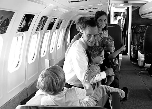 BLACK AND WHITE VERSION - US Republican presidential candidate Mitt Romney plays with the five children of his son Josh aboard his plane on September 18, 2012 in Salt Lake City.     AFP PHOTO/Nicholas KAMM        (Photo credit should read NICHOLAS KAMM/AFP/GettyImages) Photo: NICHOLAS KAMM, AFP/Getty Images / 2012 AFP