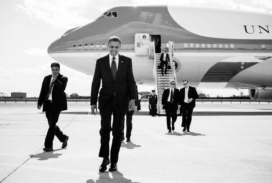 """BLACK AND WHITE VERSION - US President Barack Obama arrives at John F. Kennedy International Airport September 24, 2012 in New York.  Obama is traveling for a two day trip to New York City where he will participate in a taping of """"The View"""" before attending the United Nations General Assembly and related events.  AFP PHOTO/Brendan SMIALOWSKI        (Photo credit should read BRENDAN SMIALOWSKI/AFP/GettyImages) Photo: BRENDAN SMIALOWSKI, AFP/Getty Images / 2012 AFP"""