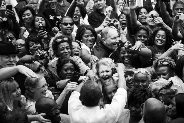 "BLACK AND WHITE VERSION - US President Barack Obama greets supporters after speaking at a campaign event at Eden Park September 17, 2012 in Cincinnati, Ohio. Obama said Monday he liked to ""walk the walk, not just talk the talk"" on combating China trade abuses, in a sharp jab at his Republican foe Mitt Romney. Obama, unveiling a new trade enforcement action against Beijing, struck a highly populist note as he sought to lock in his polling advantage over Romney in the crucial swing state of Ohio.  AFP PHOTO/Brendan SMIALOWSKI        (Photo credit should read BRENDAN SMIALOWSKI/AFP/GettyImages) Photo: BRENDAN SMIALOWSKI, AFP/Getty Images / 2012 AFP"