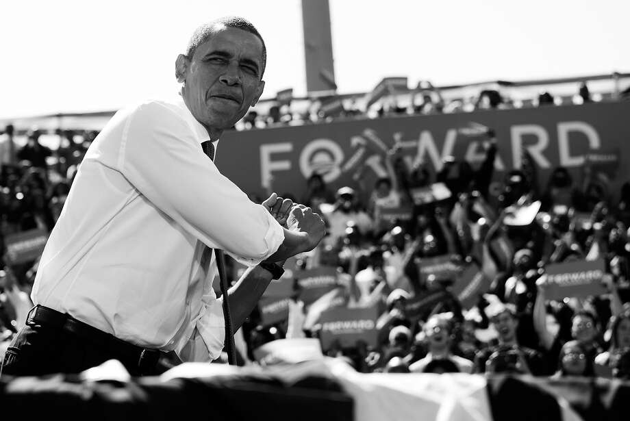 BLACK AND WHITE VERSION - US President Barack Obama poses in a batting stance like a baseball player prior to speaking during a campaign rally at G. Richard Pfitzner Stadium in Woodbridge, Virginia, September 21, 2012. AFP PHOTO / Saul LOEB        (Photo credit should read SAUL LOEB/AFP/GettyImages) Photo: SAUL LOEB, AFP/Getty Images / 2012 AFP