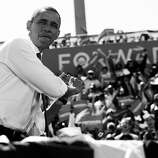 BLACK AND WHITE VERSION - US President Barack Obama poses in a batting stance like a baseball player prior to speaking during a campaign rally at G. Richard Pfitzner Stadium in Woodbridge, Virginia, September 21, 2012. AFP PHOTO / Saul LOEB        (Photo credit should read SAUL LOEB/AFP/GettyImages)