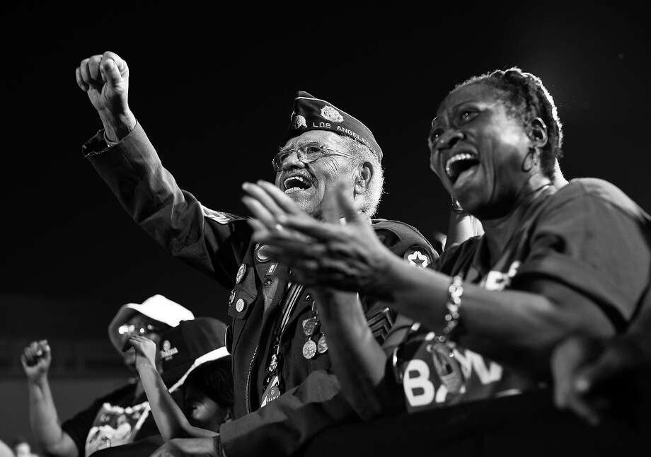 BLACK AND WHITE VERSION - Supporters cheer as  US President Barack Obama speaks at a campaign rally September 30, 2012 at Desert Pines High School Campaign in Las Vegas, Nevada.  AFP PHOTO/Mandel NGAN        (Photo credit should read MANDEL NGAN/AFP/GettyImages) Photo: MANDEL NGAN, AFP/Getty Images / 2012 AFP