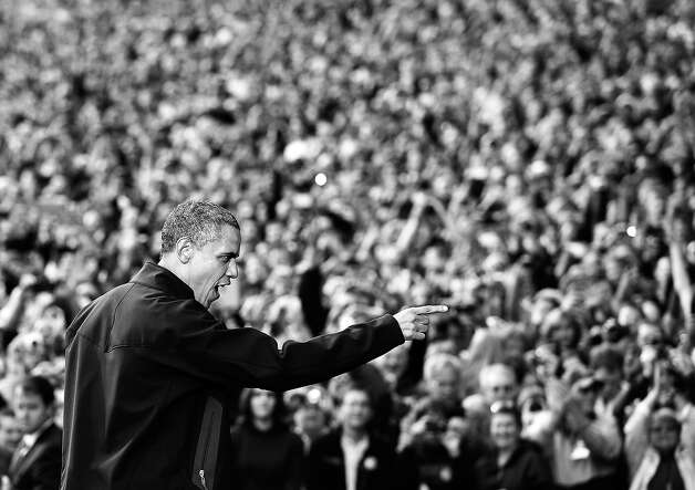 BLACK AND WHITE VERSION - US President Barack Obama gestures to supporters as he arrives onto the stage for a campaign rally October 4, 2012 at the University of Wisconsin- Madison in Madison, Wisconsin. Obama returned to the campaign trail after taking part in the first presidential debate on October 3, 2012 in Denver. AFP PHOTO/Mandel NGAN        (Photo credit should read MANDEL NGAN/AFP/GettyImages) Photo: MANDEL NGAN, AFP/Getty Images / 2012 AFP
