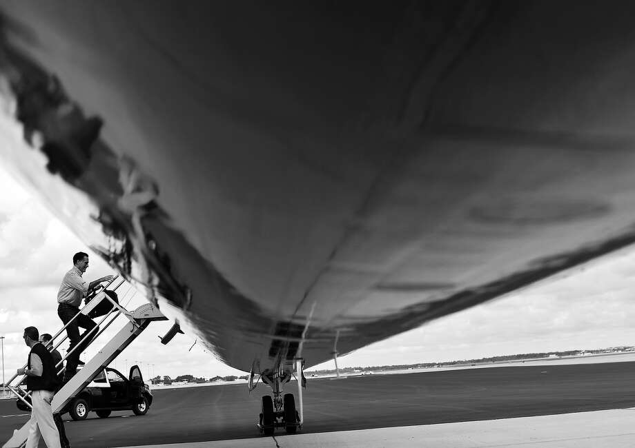 BLACK AND WHITE VERSION - US Republican presidential candidate Mitt Romney boards his campaign plane on October 7, 2012 in Orlando, Florida.  AFP PHOTO/Jewel Samad        (Photo credit should read JEWEL SAMAD/AFP/GettyImages) Photo: JEWEL SAMAD, AFP/Getty Images / 2012 AFP