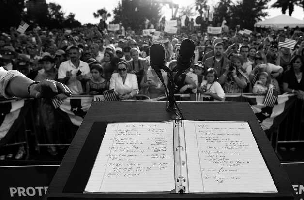 BLACK AND WHITE VERSION - Notes are seen on the podium after US Republican presidential candidate Mitt Romney addressed supporters during a campaign rally in Port Saint Lucie, Florida, on October 7, 2012. US President Barack Obama's campaign intensified attacks Sunday on Romney's honesty as it tried to halt the Republican challenger's momentum after a strong first debate performance. Romney's people hit back, and did so sarcastically, depicting Obama's people as childish sore losers after he came across as flat, nervous and unassertive during their first face-to-face encounter in Denver, Colorado.     AFP PHOTO/Jewel Samad        (Photo credit should read JEWEL SAMAD/AFP/GettyImages) Photo: JEWEL SAMAD, AFP/Getty Images / 2012 AFP
