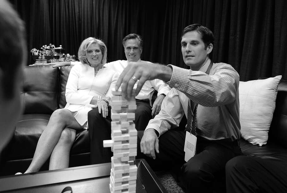 BLACK AND WHITE VERSION - US Republican challenger Mitt Romney and his wife Ann watch their children and grandchildren playing a game before the start of the first presidential debate at the university of Denver on October 3, 2012 in Denver, Colorado. AFP PHOTO/Jewel Samad        (Photo credit should read JEWEL SAMAD/AFP/GettyImages) Photo: JEWEL SAMAD, AFP/Getty Images / 2012 AFP