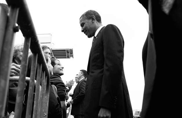 BLACK AND WHITE VERSION - US President Barack Obama (C) greets supporters at Toledo Express Airport in Bowling Green, Ohio, on September 26, 2012. Obama has widened his lead in the two main battleground states in the 2012 White House race as well as in Pennsylvania, according to a new opinion poll released Wednesday. AFP PHOTO/Jewel Samad        (Photo credit should read JEWEL SAMAD/AFP/GettyImages) Photo: JEWEL SAMAD, AFP/Getty Images / 2012 AFP