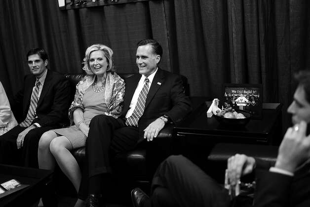 BLACK AND WHITE VERSION  Republican Presidential candidate Mitt Romney (C), his wife Ann and son Matt (L) await in a holding room, the start of the second presidential debate at Hofstra University in Hempstead, New York, October 16, 2012. US President Barack Obama and Romney will face off in a town-hall style debate with undecided voters asking questions of the two candidates. AFP PHOTO/Emmanuel DUNAND Photo: EMMANUEL DUNAND, AFP/Getty Images / 2012 AFP