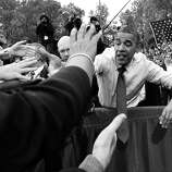 BLACK AND WHITE VERSION  US President Barack Obama greets supporters during a campaign rally at George Mason University in Fairfax, Virginia, on October 19, 2012. The election will take place on November 6.   AFP PHOTO/Jewel Samad