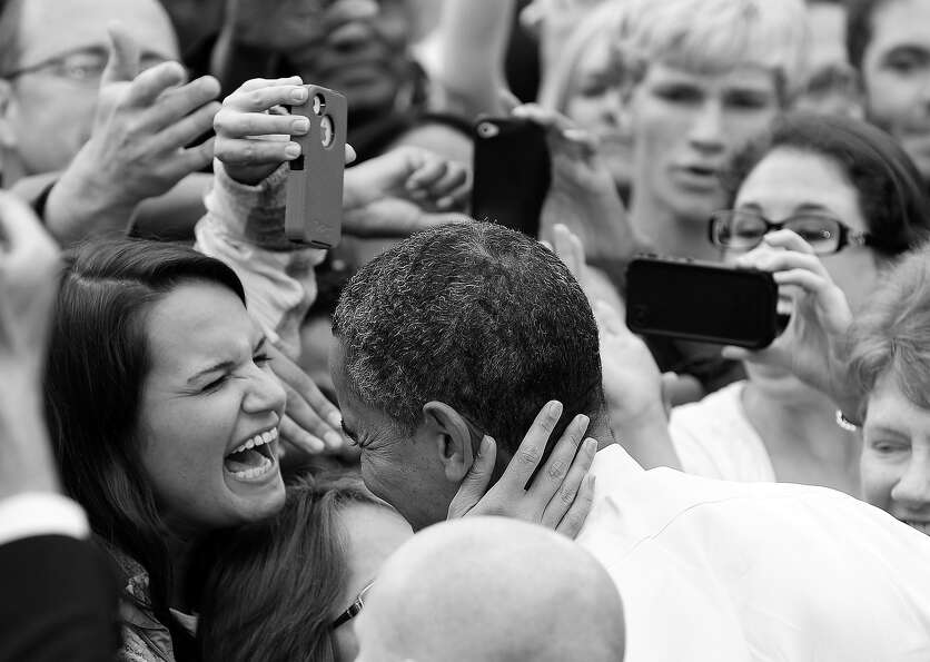 BLACK AND WHITE VERSION  US President Barack Obama greets supporters during a campaign rally at Geor
