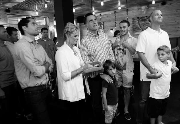 BLACK AND WHITE VERSION  US Republican presidential candidate Mitt Romney orders food with members of his family at BurgerFi restaurant in Delray Beach, Florida, on October 21, 2012. (L-R) son Craig, wife Ann and grandson Parker.   AFP PHOTO/Emmanuel DUNAND Photo: EMMANUEL DUNAND, AFP/Getty Images / 2012 AFP