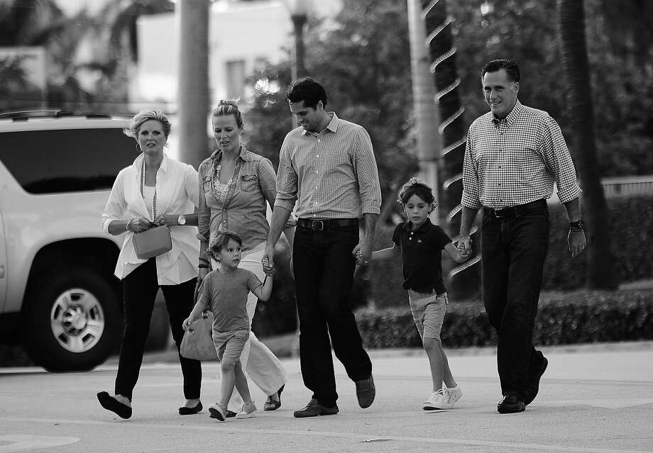 BLACK AND WHITE VERSION  US Republican presidential candidate Mitt Romney (R) arrives to have dinner with members of his family at BurgerFi restaurant in Delray Beach, Florida, October 21, 2012. (L-R) Wife Ann, daughter in-law Mary, grandson Miles, son Craig, and grandson Parker.    AFP PHOTO/Emmanuel DUNAND Photo: EMMANUEL DUNAND, AFP/Getty Images / 2012 AFP