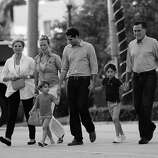 BLACK AND WHITE VERSION  US Republican presidential candidate Mitt Romney (R) arrives to have dinner with members of his family at BurgerFi restaurant in Delray Beach, Florida, October 21, 2012. (L-R) Wife Ann, daughter in-law Mary, grandson Miles, son Craig, and grandson Parker.    AFP PHOTO/Emmanuel DUNAND