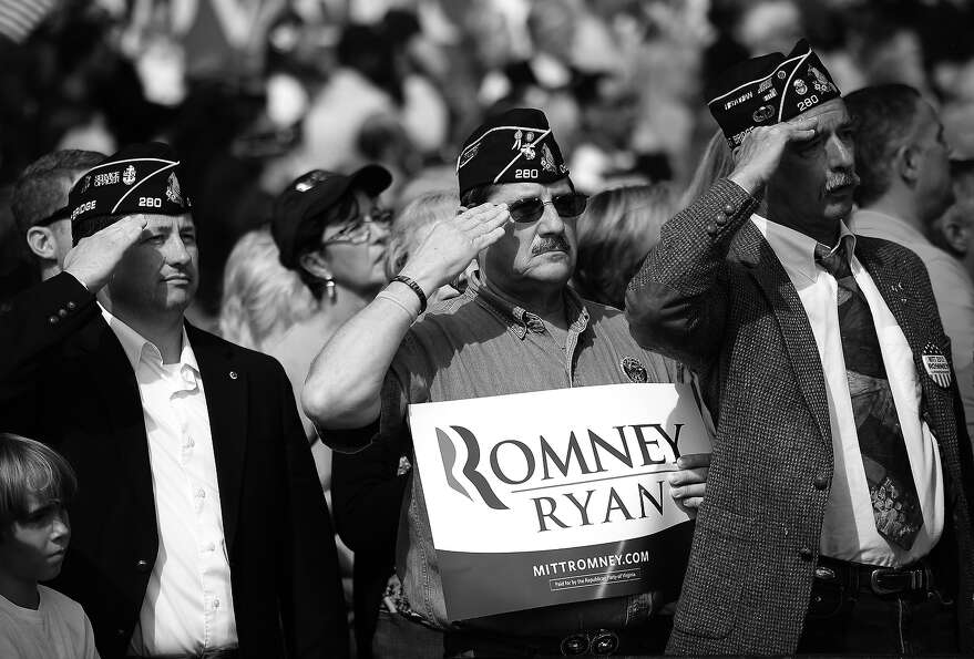 BLACK AND WHITE VERSION US military veterans salute while attending a Republican presidential candid
