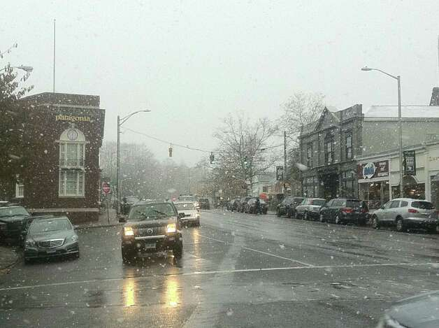 Snow startat to fall in the downtown business district at midday Wedneday, the leading edge of what weather forecasters is a nor'easter poised to buffet the region with snow, rain, high winds and coastal flooding. Westport CT 11/7/12 Photo: Paul Schott / Westport News