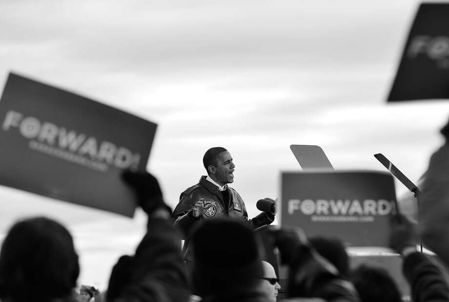 BLACK AND WHITE VERSION US President Barack Obama speaks during a campaign rally at Austin Straubel International Airport in Green Bay, Wisconsin, on November 1, 2012. AFP PHOTO/Jewel Samad Photo: JEWEL SAMAD, AFP/Getty Images / 2012 AFP