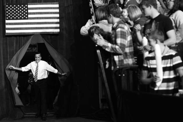 BLACK AND WHITE VERSION US Republican Presidential candidate Mitt Romney arrives for a rally in Des Moines, Iowa, November 4, 2012.  AFP PHOTO/Emmanuel DUNAND Photo: EMMANUEL DUNAND, AFP/Getty Images / 2012 AFP