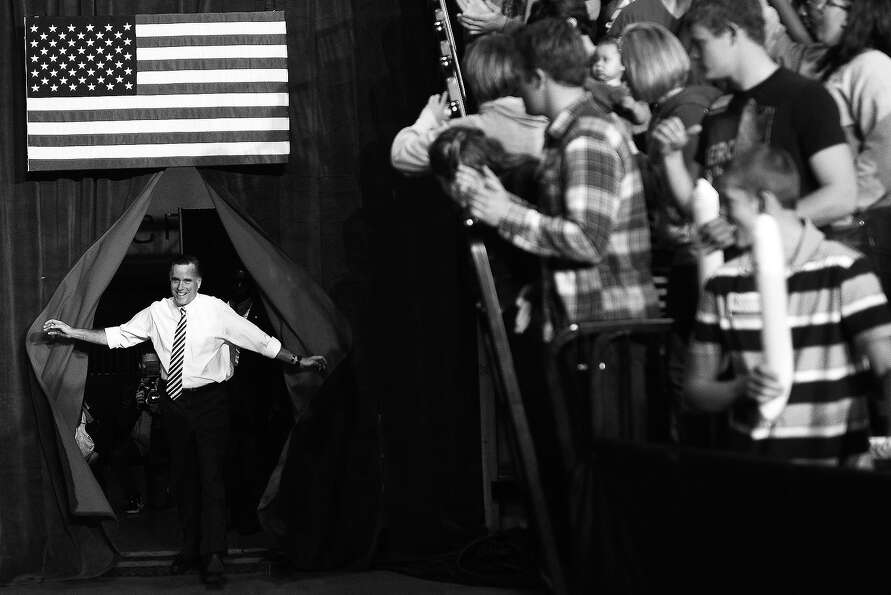 BLACK AND WHITE VERSION US Republican Presidential candidate Mitt Romney arrives for a rally in Des