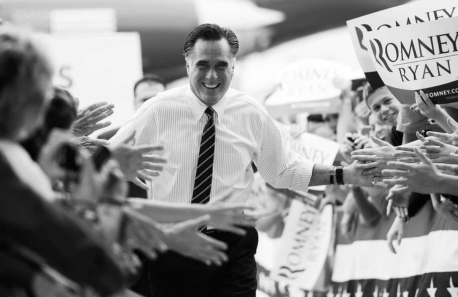 BLACK AND WHITE VERSION US Republican Presidential candidate Mitt Romney holds a rally at Orlando Sanford international airport in Orlando, Florida, November 5, 2012. Romney and US President Barack Obama are mounting last ditch efforts to hold key battleground states, one day before the US presidential elections.    AFP PHOTO/Emmanuel DUNAND Photo: EMMANUEL DUNAND, AFP/Getty Images / 2012 AFP
